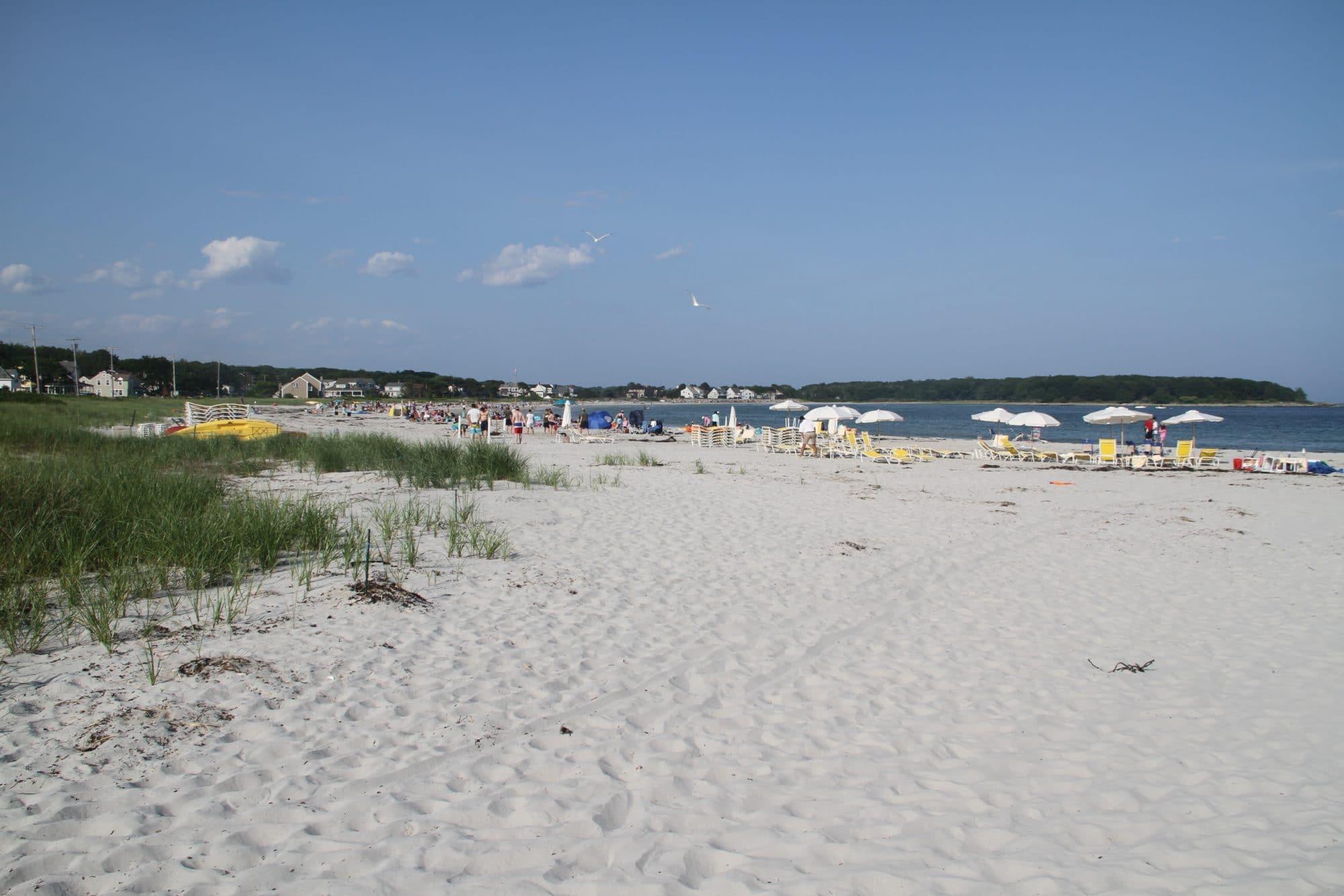 goose-rocks-beach-umbrellas-white